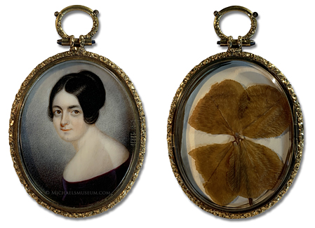 Miniature portrait of a Jacksonian Era American lady (artist unknown) with a rare, dry-pressed four-leaf clover to the reverse