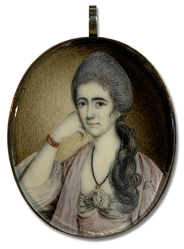 Miniature portrait of a Georgian Era lady wearing her deceased husband's wedding ring at her neck and his miniature portrait in a bracelet on her wrist